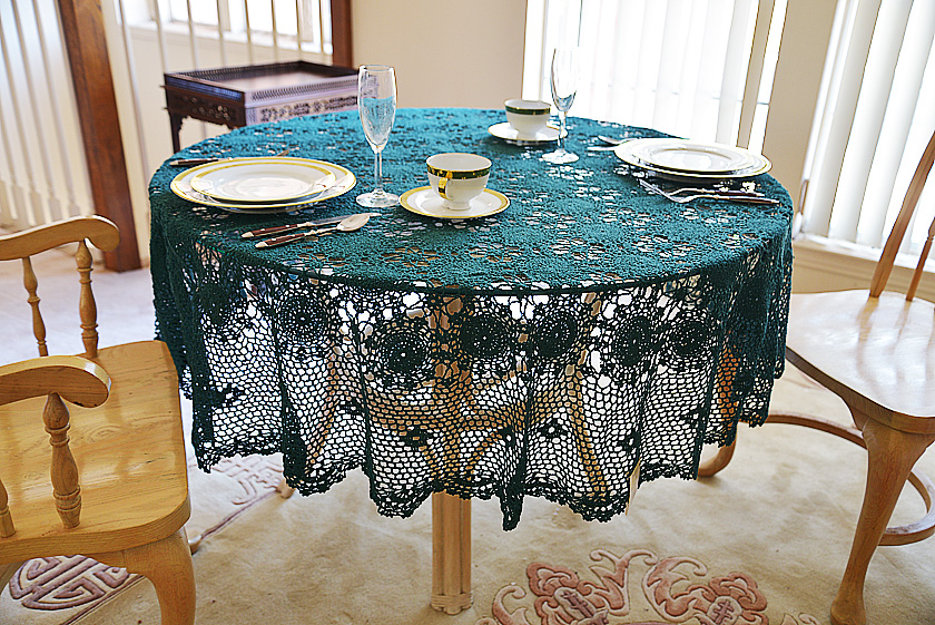 festive every green colored crochet round tablecloth