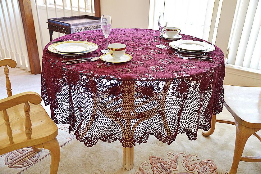 Festive Merlot colored crochet round tablecloth