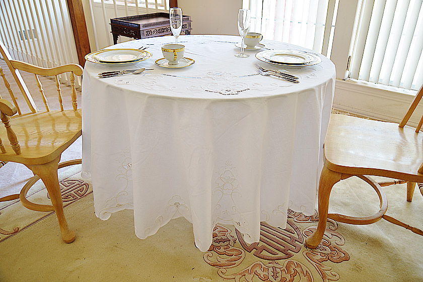 white embroidered round tablecloth