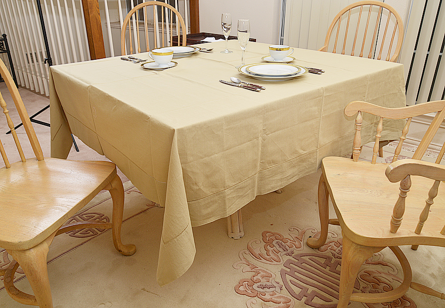 """70"""" square tablecloth. Taupe colored"""