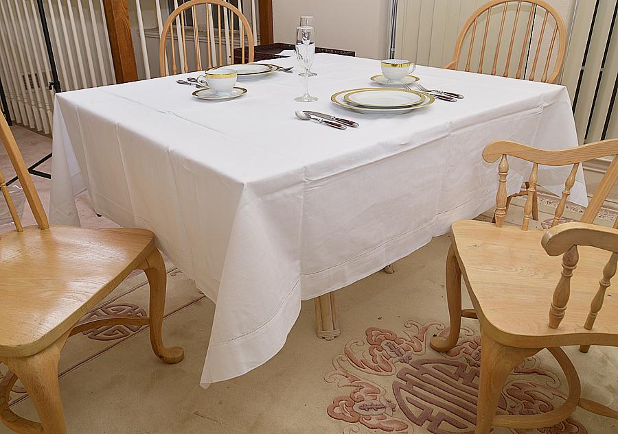 """70"""" square tablecloth. white colored"""