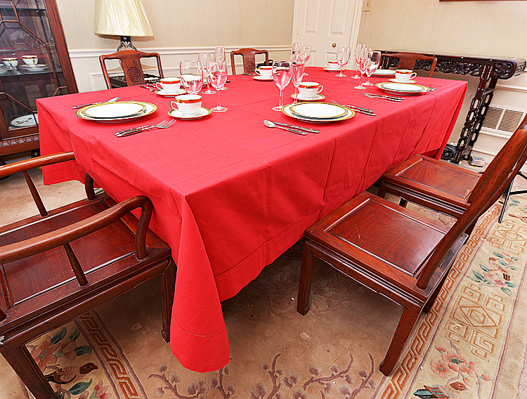 Red colored rectangular tablecloht